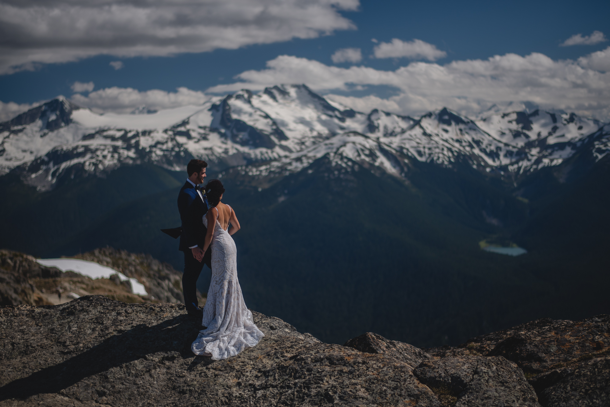 bride and groom at the top of whistler mountain