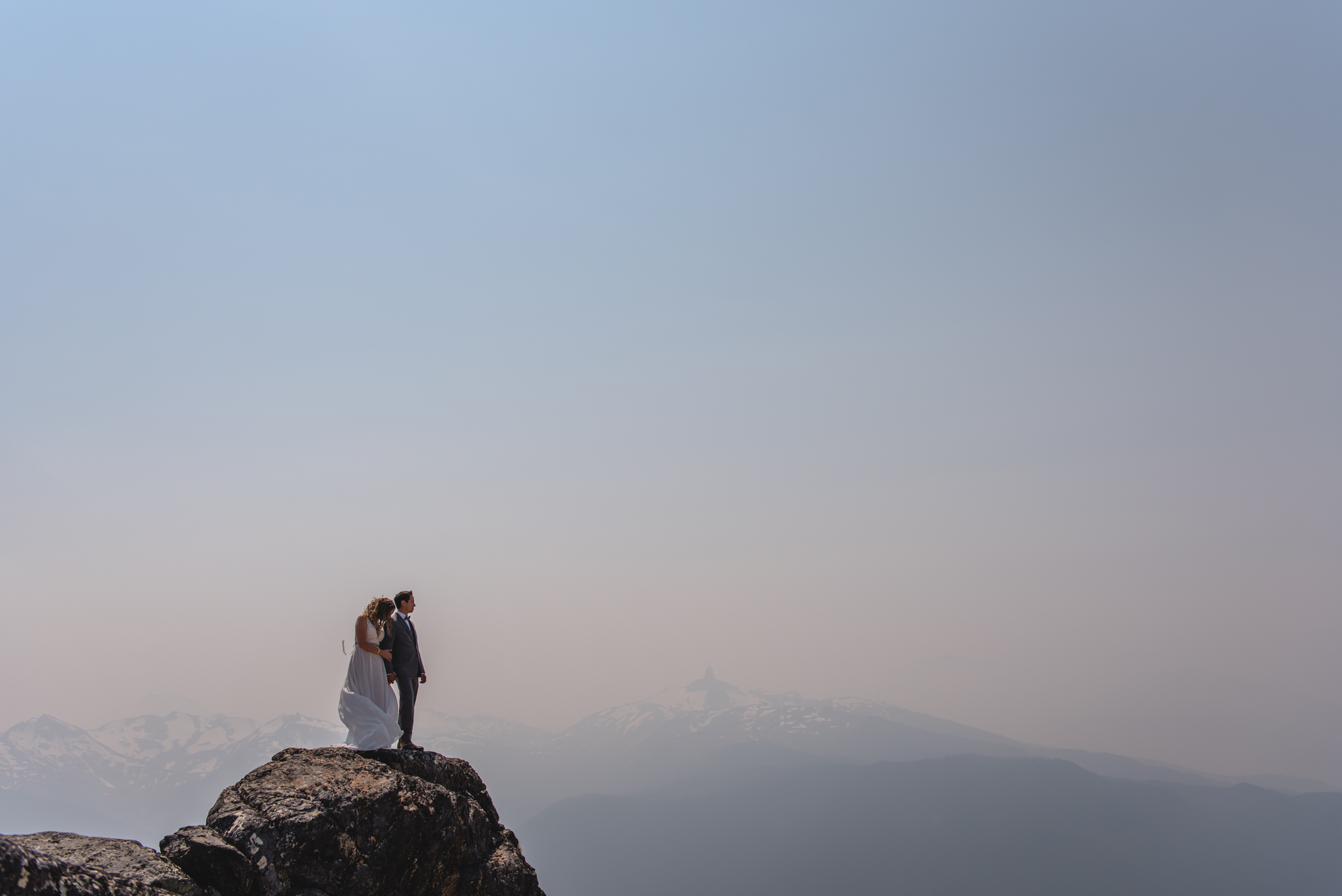 whistler peak wedding couple with black tusk
